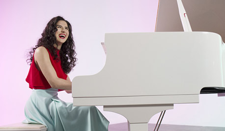Laila Biali with a white piano