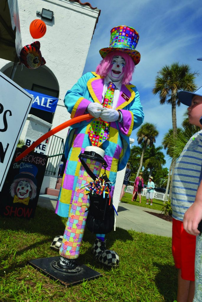 clown making balloon animals