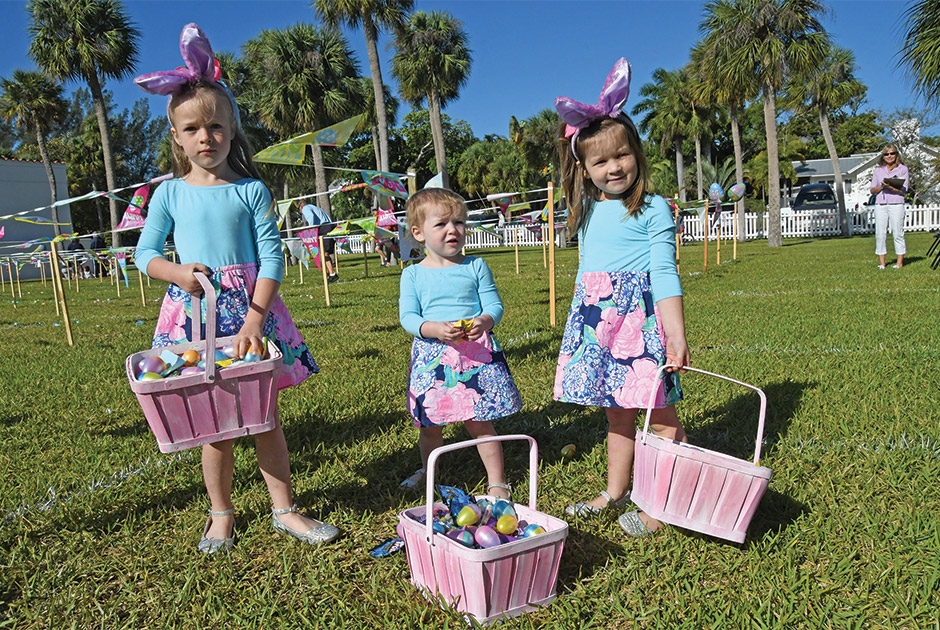 three little girls with Easter baskets and bunny ears