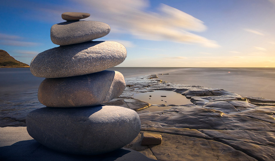 stack of smooth stones near the ocean
