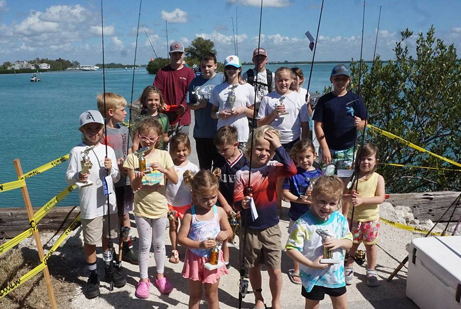 kids and adults with fishing gear
