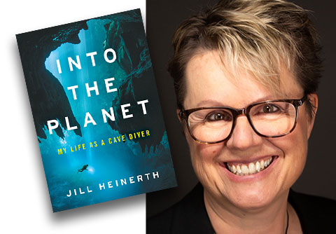 Jill Heinerth with book cover, Into the Planet: My Life as a Cave Diver