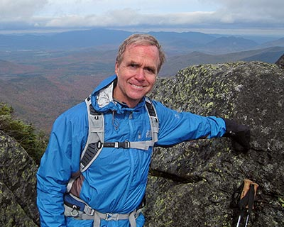 Tom Cross hiking in the mountains