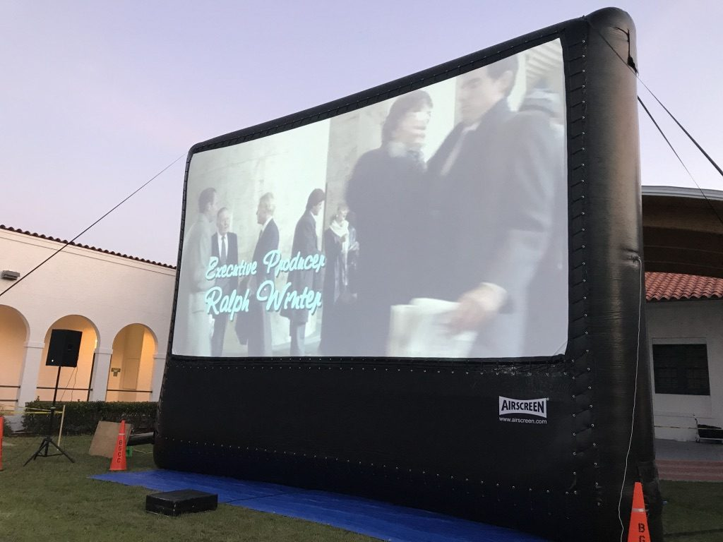 movie playing on outdoor screen