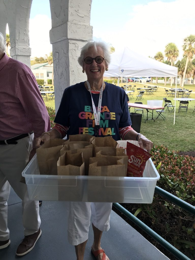volunteer serving popcorn