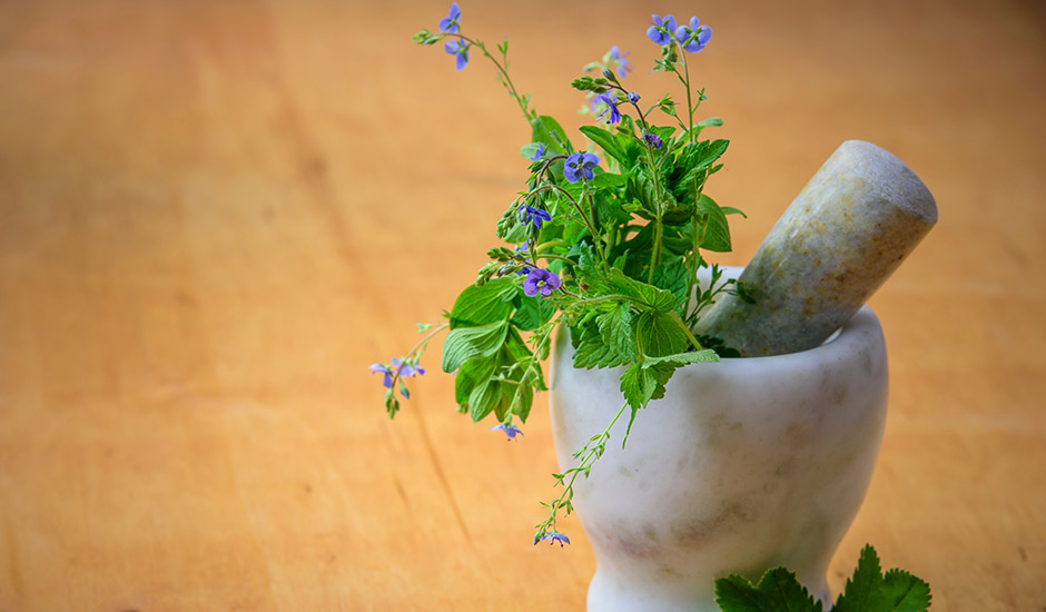 herbs with a mortar and pestle