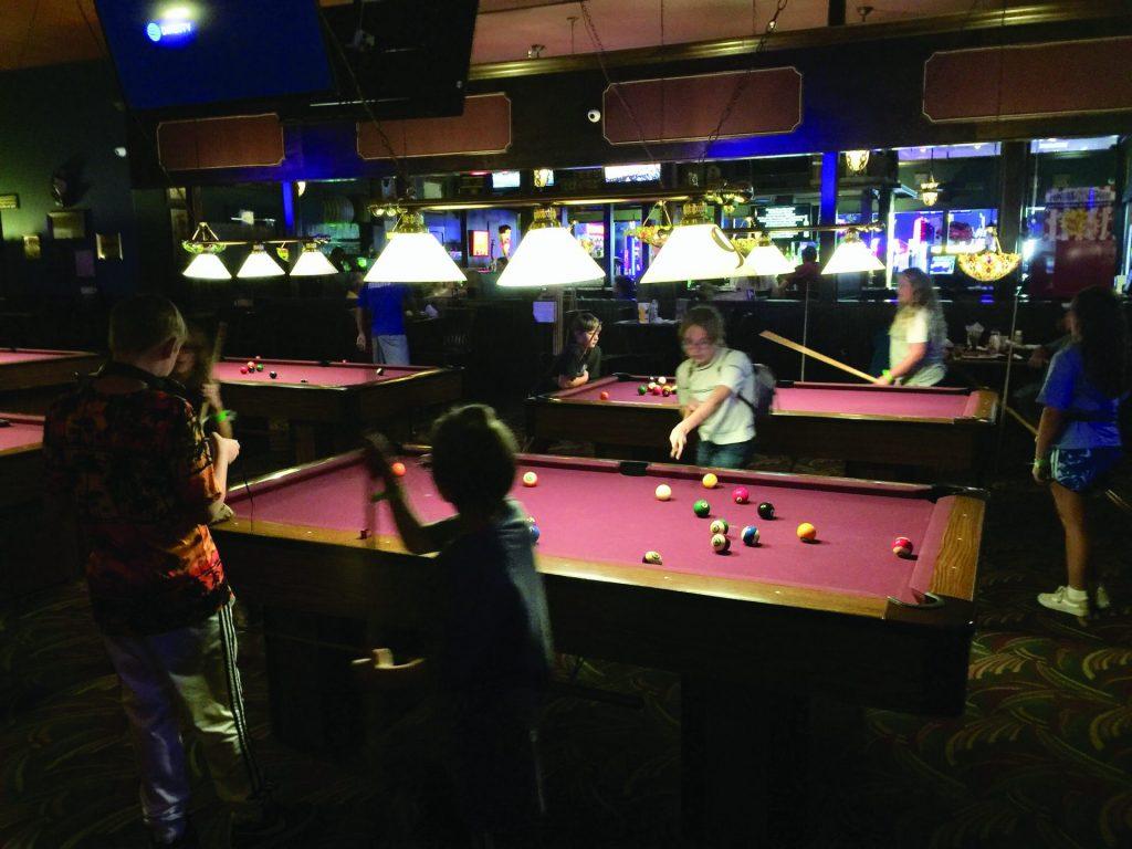 kids playing billiards