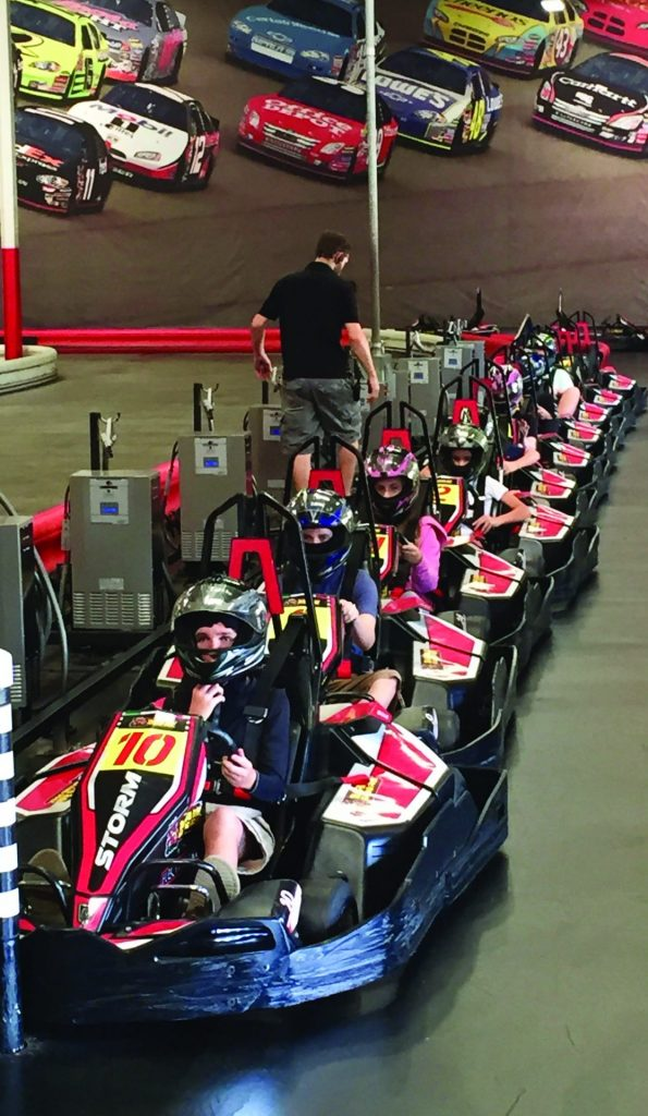 go-carts lined up on a track